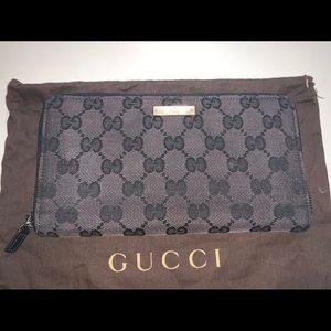 Authentic Gucci zippy organizer travel wallet case